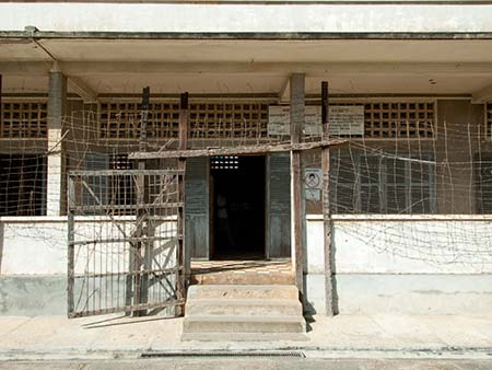 Barbed-wire fence and entrance to Building C at Security Prison 21