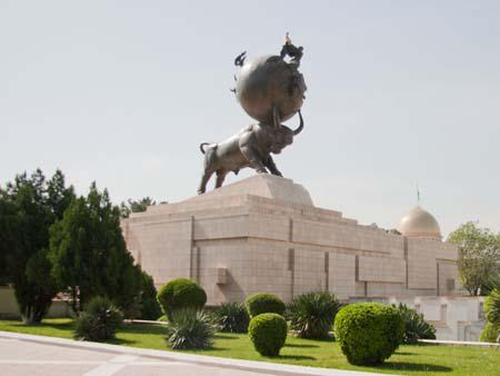 Earthquake memorial, a bull with a globe and a women holding a child
