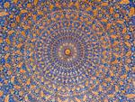 The inner dome painted blue and gold in the Tilla-Kari Medressa part of the Registan