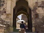 Sonya walking through the main multi gates of Dodh Kangra Pol entrance to Mehrangarh Fort