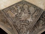 Painted column capital of man on beast in Zand bath