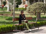Sonya resting on a bench in Golestan Palace gardens