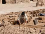 A man creating mud bricks, used to restore Narin Castle