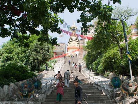 The stairs leading to the large stupa visible at the top